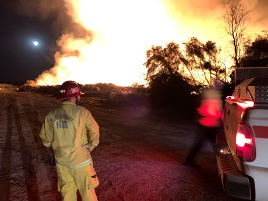 Cal Fire firefighters watched the Martinez Fire burn on a 120-acre dump in Thermal on Monday, Oct. 14, 2019.