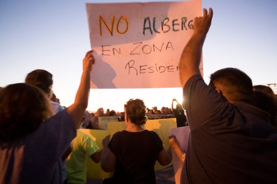 Residents of Mexicali, Mexico gather to protest the possible opening of a migrant shelter for MPP migrants from Central America who are waiting for a court hearing in the U.S. in order to seek asylum. The residents are worried about the migrants devaluing their property, possible violence and the safety of school age children on Monday, Oct. 14, 2019.