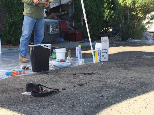 Investigators display items found in an apartment at Vista Chino and Via Miraleste in Palm Springs on Tuesday, Oct. 15, 2019. They're used for making honey oil and the process caused an explosion Tuesday morning, police said.