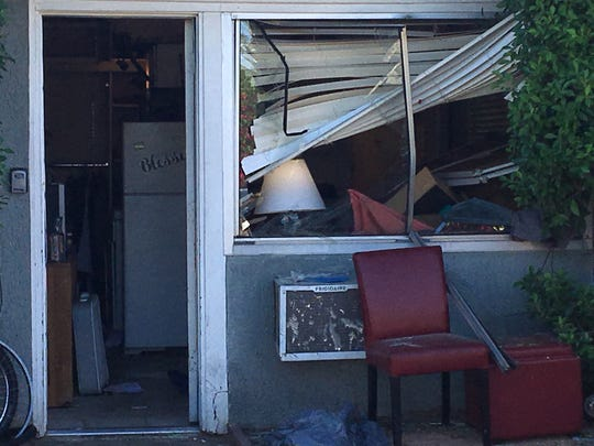A blown-out window shows the force of an explosion at this studio apartment at Vista Chino and Via Miraleste in Palm Springs on Tuesday, Oct. 15, 2019. It was caused by a honey oil lab explosion, police said.