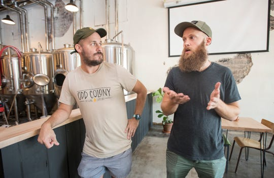 Blake Foster, left, and Brett Schweigert, co-founders of Odd Colony Brewing Co., talk Tuesday about opening the new brewery in downtown Pensacola.