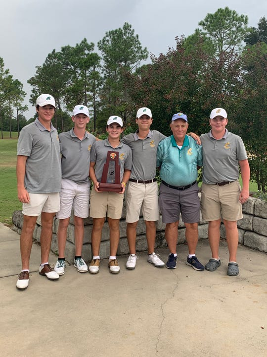 The Pensacola Catholic golf team celebrates its District 1-1A title won in Chipley on Oct. 14, 2019.