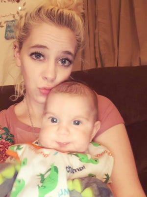Nicole Cash and her 9-month-old son Javion Wertz.