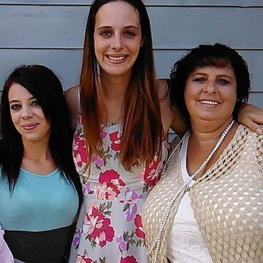 Nicole Cash, left, poses with her sister Amber Donnelly, middle, and her mom Sandra Green.