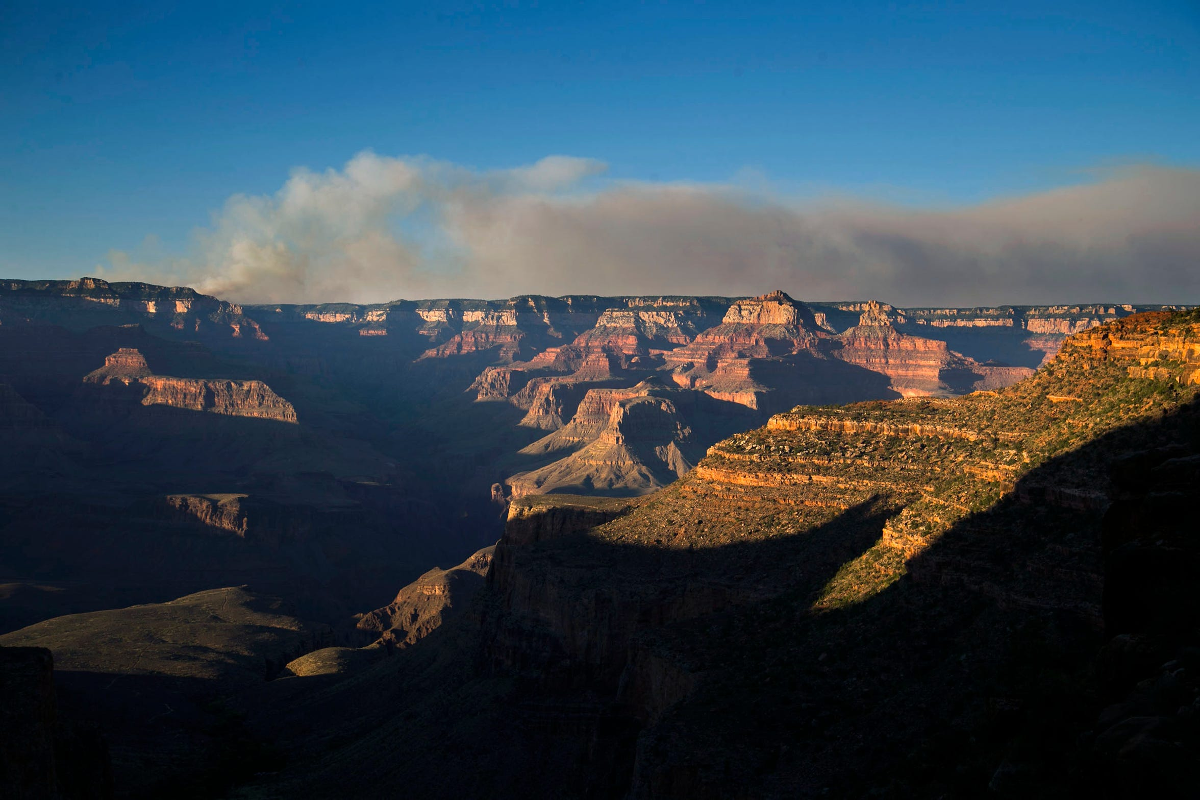 The Fuller Fire burns on the north rim of the Grand Canyon as seen from the Bright Angel Trail below the south rim of the canyon in Grand Canyon National Park on  July 14, 2016.