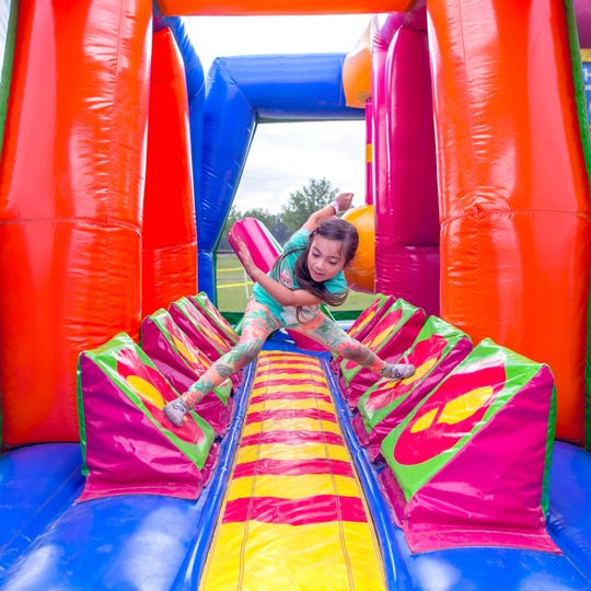 Kids and adults can take on the challenge of a 900-foot obstacle course as part of the Big Bounce American tour.