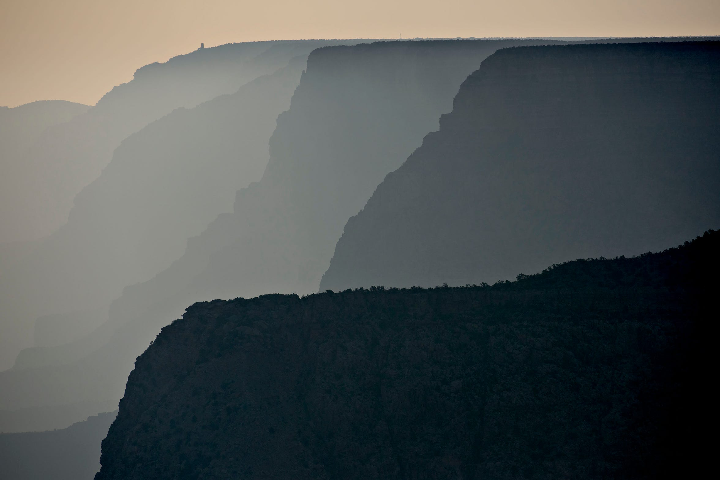 Smoke from a nearby forest fire is illuminated by the rising sun at Grand Canyon National Park on June 26, 2015.