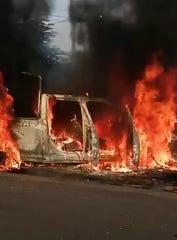 Vista general este lunes de una patrulla de la policía estatal incinerada tras ser emboscada por un grupo armado en Aguililla, estado Michoacán (México).