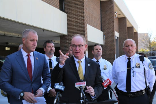 Rep. Sean Patrick Maloney (left,) Mayor Rob Rolison and Police Chief Tom Pape stand with members of the police force outside the department on Tuesday, Oct. 15, 2019. The leaders announced that the city has access to $630,000 in federal funding for the police department.