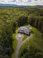 The home on 10.65 wooded acres at 126 Old Hopewell Road in Wappingers Falls is on the market for $2.8 million.