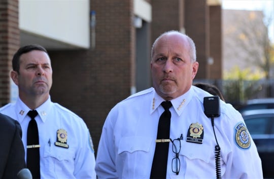 Capt. Richard Wilson and Police Chief Tom Pape stand with members of the police force outside the department on Tuesday, Oct. 15, 2019. The leaders announced that the city has access to $630,000 in federal funding for the police department.