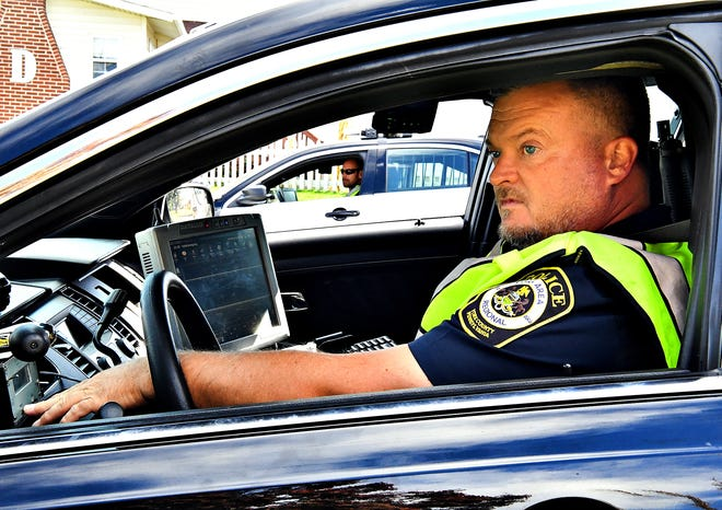 York Area Regional Police Officers James Hess Jr., front, and Michael Schiffhauer monitor traffic along Cape Horn Road at Skylight Drive using ENRADD, a non radar speed detection system, in Windsor Township, Tuesday, Oct. 15, 2019. Hess, a 17-year veteran with the department, says motor vehicle accidents occur frequently in the area. Dawn J. Sagert photo
