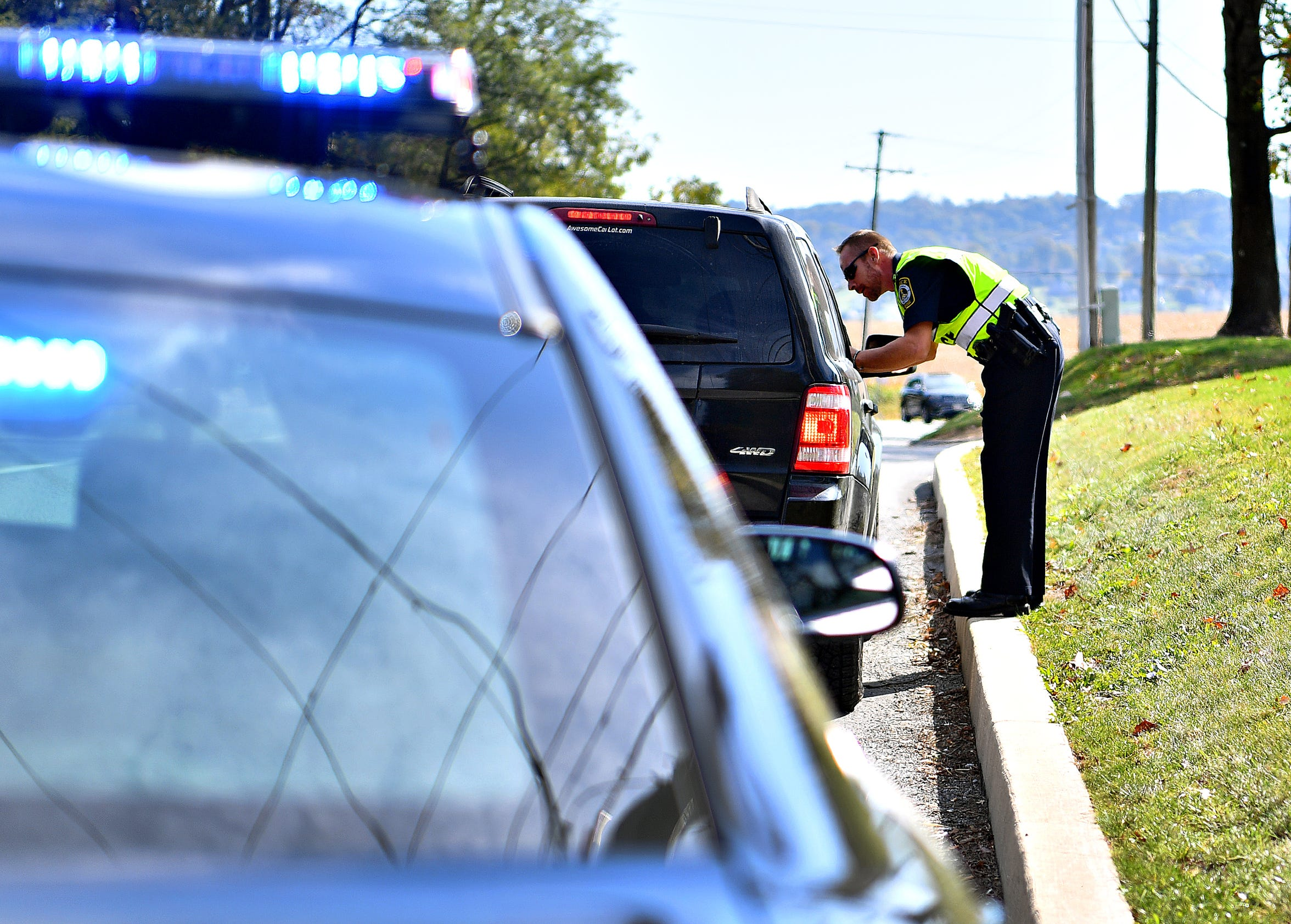York Area Regional Police Officer Michael Schiffhauer makes a traffic stop on Cape Horn Road using ENRADD (Electronic Non Radar Device) in Windsor Township, Tuesday, Oct. 15, 2019. Dawn J. Sagert photo