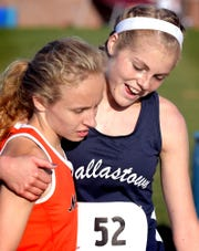Dallastown's Emily Schuler hugs Northeastern's Margaret Carroll, left, after the girls' York-Adams League cross country championships at Gettysburg High School Tuesday, Oct. 15, 2019. Carroll finished first and Schuler second. Bill Kalina photo