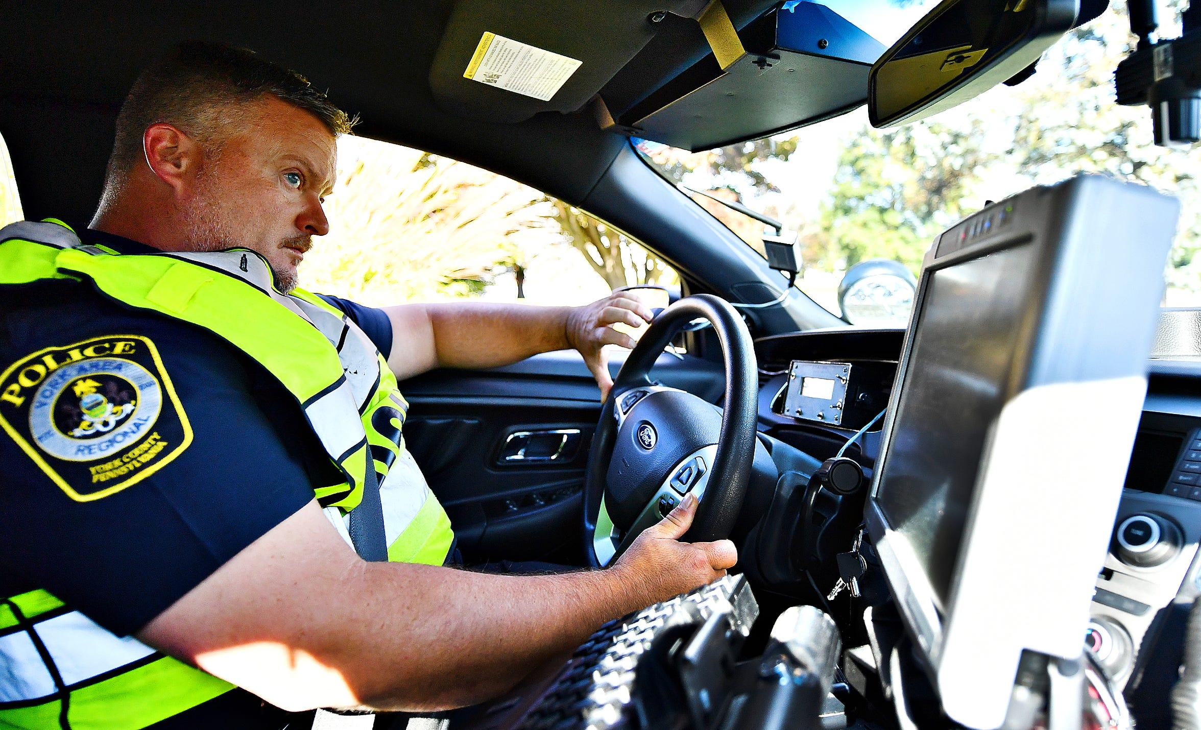 York Area Regional Police Officer James Hess Jr. monitors traffic along Cape Horn Road at Skylight Drive using ENRADD, a non radar speed detection device, in Windsor Township, Tuesday, Oct. 15, 2019. Hess says he once stopped a driver going 116 mph in the same location. Dawn J. Sagert photo