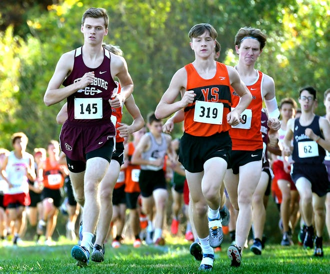 Gettysburg's Andrew Hirneisen, left, and York Suburban's Cole Adams lead the boys' race early during the York-Adams League cross country championshipsAt Gettysburg High School Tuesday, Oct. 15, 2019. Adams would finish first. Bill Kalina photo