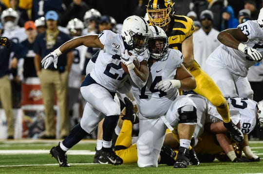 Penn State Nittany Lions running back Noah Cain's strong running late in the game helped seal the win over Iowa on Oct. 12.