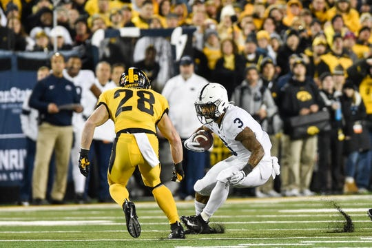 Oct 12, 2019; Iowa City, IA, USA; Penn State Nittany Lions running back Ricky Slade (3) runs with the ball as Iowa Hawkeyes defensive back Jack Koerner (28) moves in for the tackle during the third quarter at Kinnick Stadium. Mandatory Credit: Jeffrey Becker-USA TODAY Sports