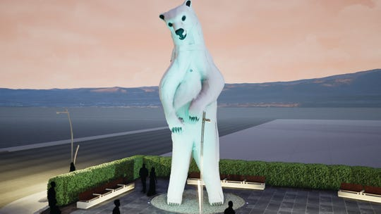 """""""Polar Bear"""" by Don Kennell and Lisa Adleris is made of scrap car hoods. It's the latest Burning Man art to be added to the Reno Neon Line."""