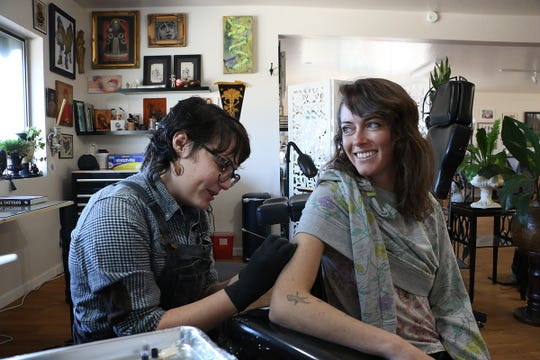 Poke tattoo artist Summer Ester Orr, left, works on client Jasmine Barber-Winter in her studio in the Twofold Tattoo shop in Reno on Oct. 12, 2019.