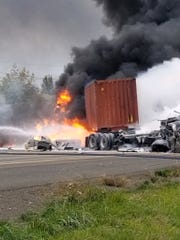 A crash involving two semi-trucks has closed all southbound lanes and one northbound lane of Interstate 5 about two miles north of Woodburn.