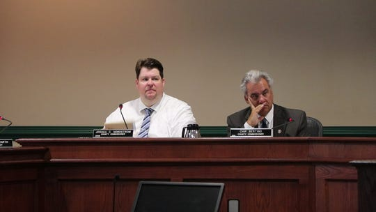"""From left: Worcester County Commissioners Joshua Nordstrom and Anthony """"Chip"""" Bertino listen to a proposal during the Aug. 20, 2019 county commissioners meeting."""