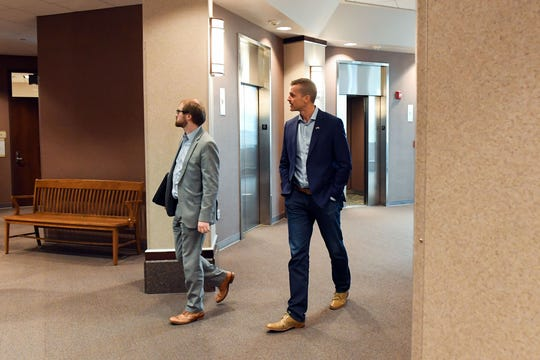 Mayor Paul TenHaken, right, arrives at the Minnehaha County Courthouse on Tuesday, October 15, in Sioux Falls to testify in the trial of a man accused of harassing public officials.
