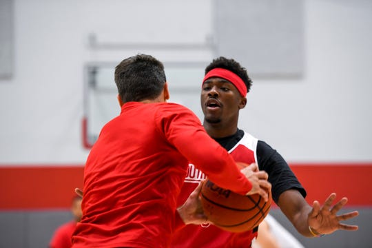 USD guard Triston Simpson guards a coach in a drill during USD basketball media day on Tuesday, Oct. 15, 2019 at the Sanford Coyote Sports Center.