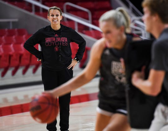 Coach Dawn Plitzuweit leads practice during USD basketball media day on Tuesday, Oct. 15, 2019 at the Sanford Coyote Sports Center.