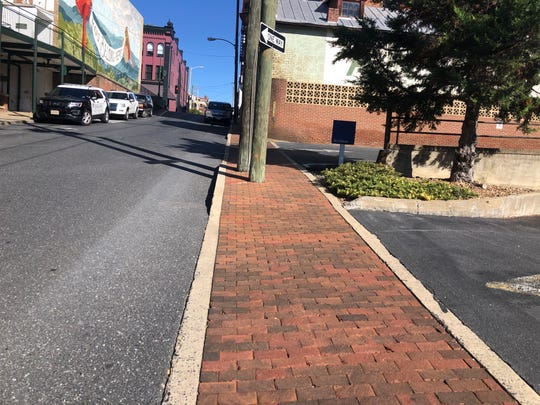 Intersections between sidewalks and parking lots, like this one on South Central Avenue,  can be challenging to navigate with a cane.