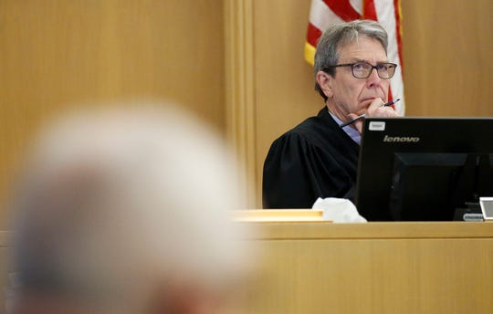 Portage County Circuit Judge Thomas Eagon looks over to the defense table during testimony on Tuesday, October 15, 2019, at the Portage County Courthouse in Stevens Point, Wis. Jason Sypher is accused of murdering his wife, Krista Sypher, who went missing in March 2017 and has not been found.Tork Mason/USA TODAY NETWORK-Wisconsin