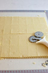 Use a pastry cutter or cookie cutter to punch out the lemon shortbread cookies.