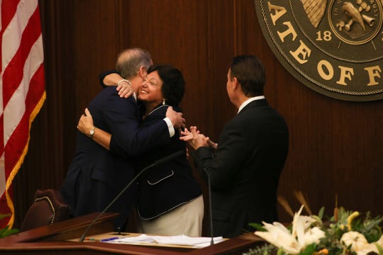 Sen. Wilton Simpson hugs Sen. Kathleen Passidomo during a meeting of the 2019 Republican Caucus where Simpson, R-Citrus, was nominated as Senate president-designate for the 2020-2022 sessions Tuesday, Oct. 15, 2019.