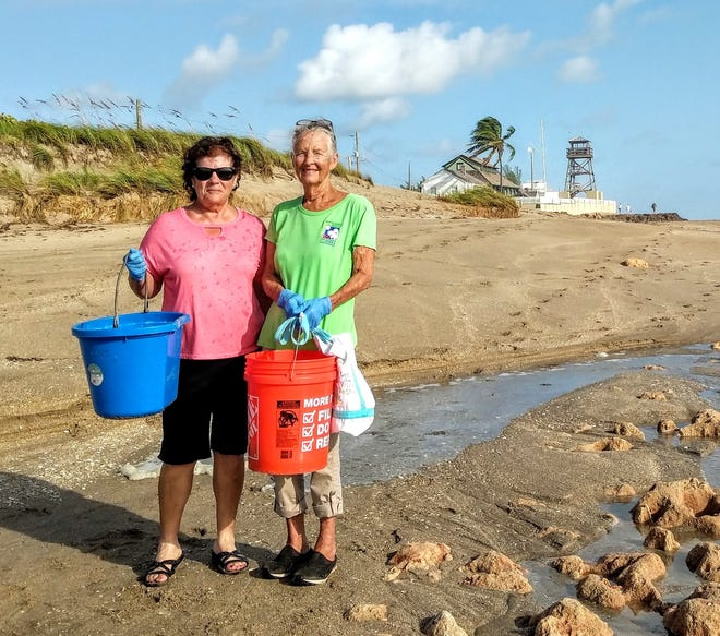 Martin County Master Gardeners Sandy Laguna, left, and Judy Johnson with beach trash collected Sept. 21, 2019, near the House of Refuge, seen in the background.