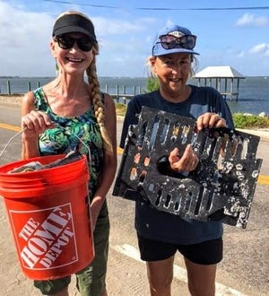 Martin County Master Gardeners Daina Karol, left, and Jody Borecki with beach trash collected Sept. 21, 2019, near the House of Refuge.