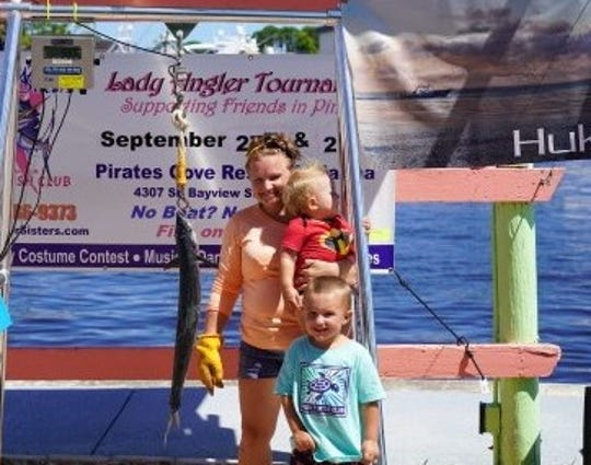 Rachelle Creech of Stuart caught the largest kingfish and won the Polly Whippen Memorial Award as the top angler in the Saltwater Sisters fishing tournament hosted by the Stuart Sailfish Club.