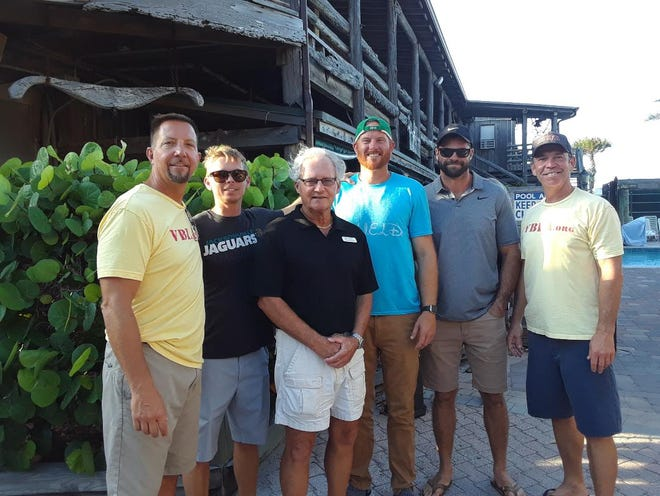 Author Alan Wolford, third from left, is with Vero Beach lifeguards, from left,  Erik Toomsoo, Patrick Sullivan, Colter Hanawalt, Vincent Valentino and Robby Rivas.
