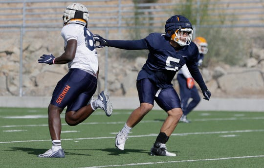 UTEP sophomore linebacker Sione Tupou covers an offenive player during Tuesday's practice at Glory Road Field.