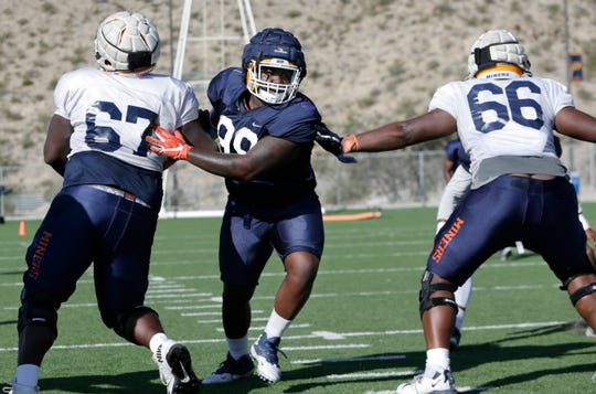 UTEP senior defensive lineman Chris Richardson gets through the offensive line during Tuesday's practice at Glory Road Field.