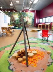 A replica campfire play area in the new outdoor exhibit at The Children's Museum of the Upstate in Greenville.