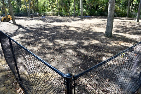 Workers erect a fence for a new dog park in Vineland located across the street from Giampietro Park at the corner of Lincoln Avenue and Laurel Road.