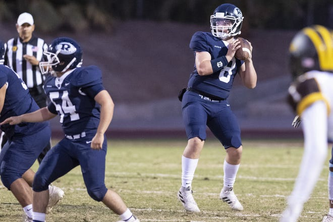 Redwood quarterback Ryan Rios drops back to pass against Golden West in a West Yosemite League high school football game on Friday, October 11, 2019.
