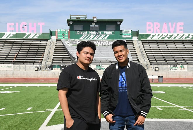 Students Yoel Lopez and Joahn Ardila-Zabala pose at the Dinuba High School stadium, where they sold more than $300 in shish kebabs to benefit their school at the homecoming game earlier this month.