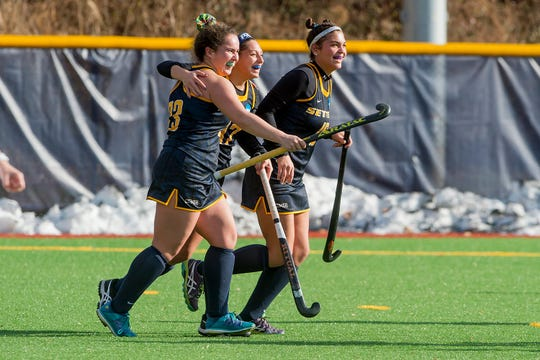 Yorktown native, Mia Lennon (left), celebrates with her Pace University field hockey teammates.