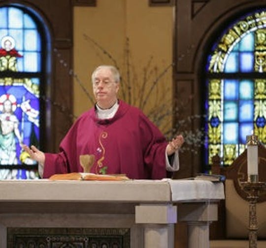Monsignor Edward Weber celebrates Mass at t. Francis of Assisi Church in West Nyack on Feb. 15, 2008. He served as the parish's pastor at the time.