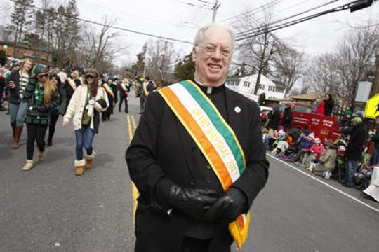 Monsignor Edward Weber serves as the grand marshal of the 51st annual Pearl River St. Patrick's Day parade on March 17, 2013.