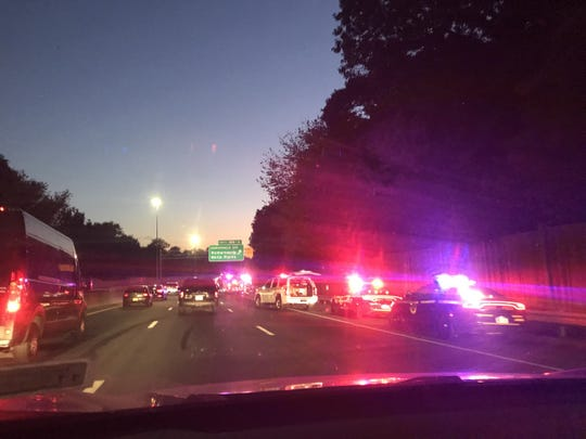A tractor trailer flipped over on its side and slowed the Tuesday evening commute on Interstate 95.