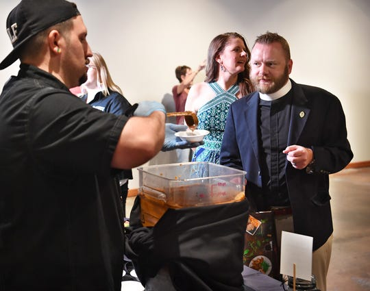 Chef Matthew Swift of Fox Hill Restaurant serves up a bowl of soup to Father Topher Rodgers during the 8th Annual Empty Bowls. The event is held at the Wichita Falls Museum of Art at Midwestern State University and raises money for the Wichita Falls Area Food Bank.