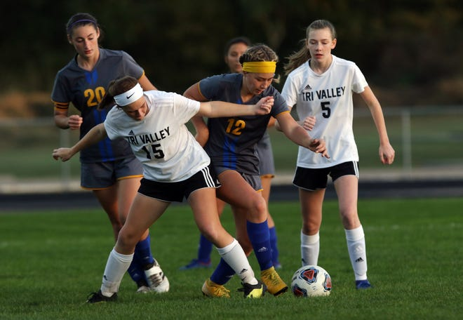 Philo's Alexis Rueckert (12) fights for the ball with Tri-Valley's Ally Barclay during the Division II sectionals on Monday.
