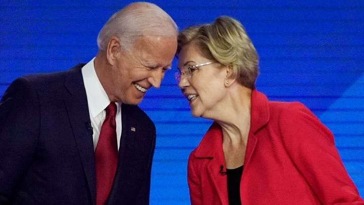 Democratic presidential candidates former Vice President Joe Biden, left and Sen. Elizabeth Warren, D-Mass., talk Sept. 12, 2019, during a Democratic presidential primary debate hosted by ABC at Texas Southern University in Houston.